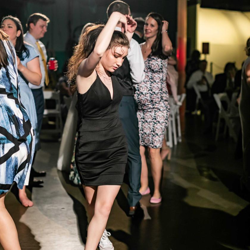 woman in black dress dancing