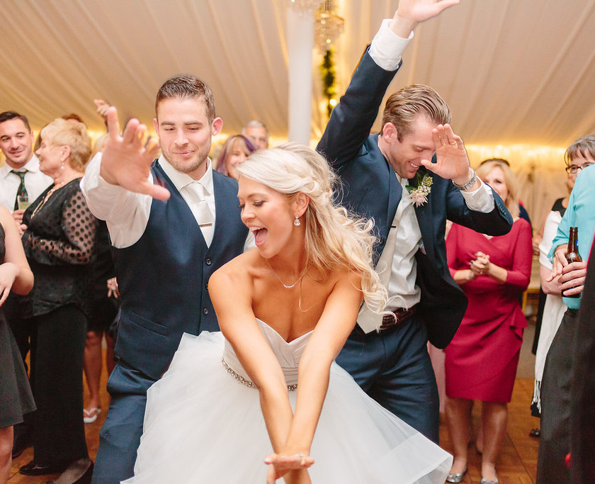 bride dancing with groom and guests