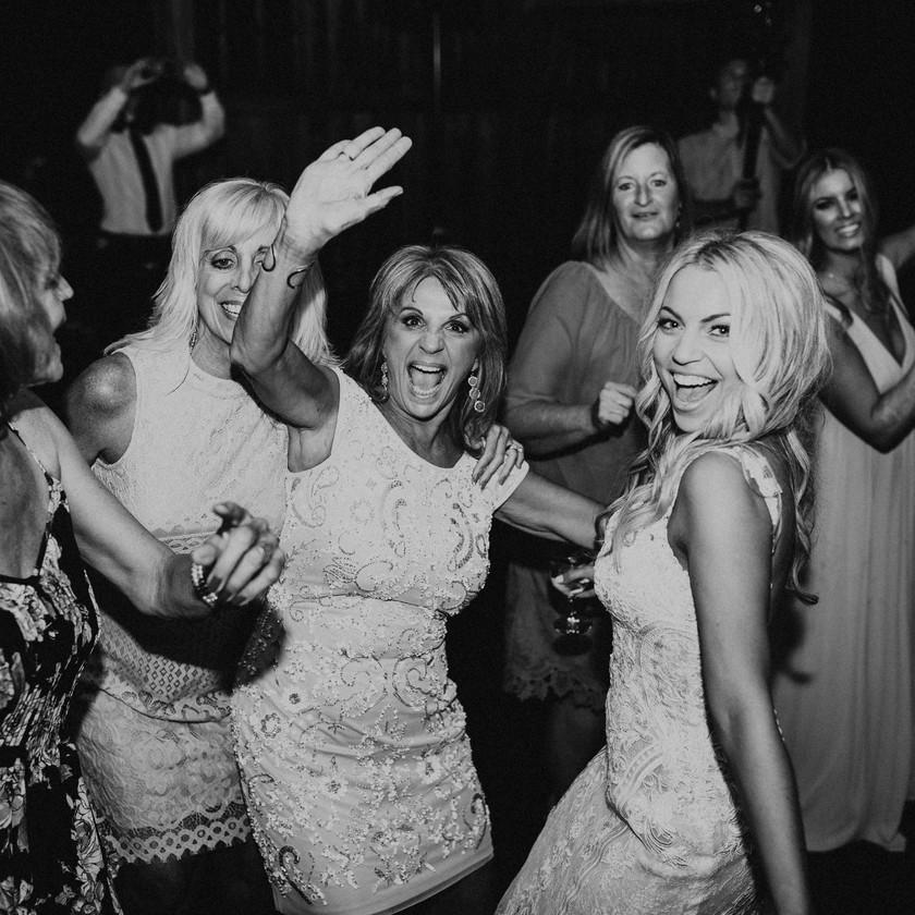 bride and women dancing at wedding