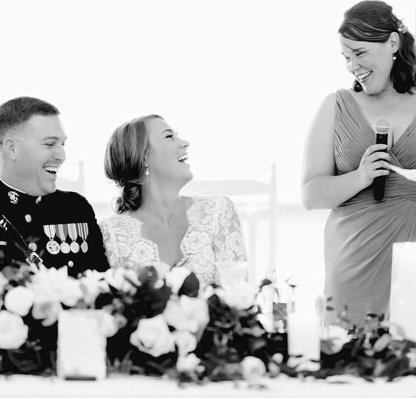 bride and groom laugh during toast
