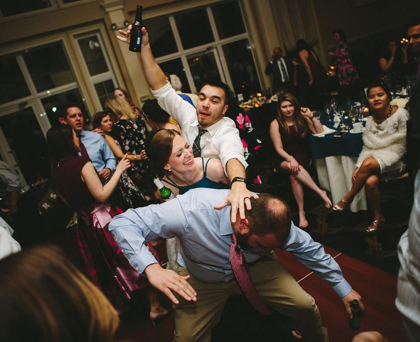 wedding guests dancing close together