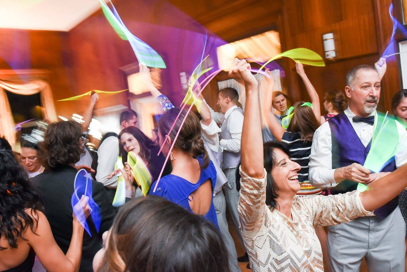 guests dance and wave glowsticks at wedding