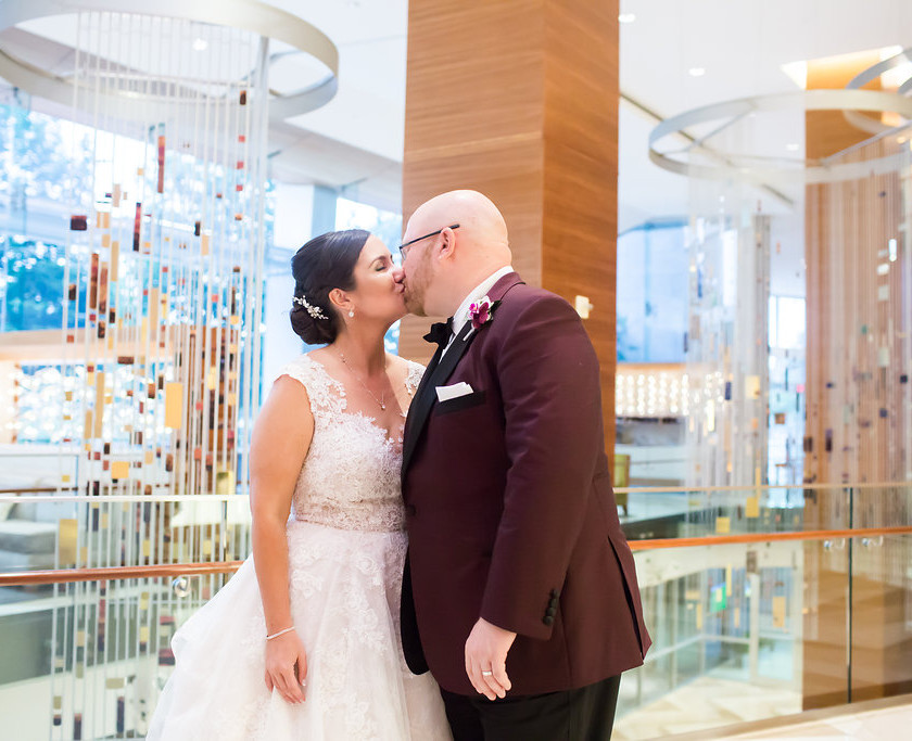 bride and groom kiss in hotel