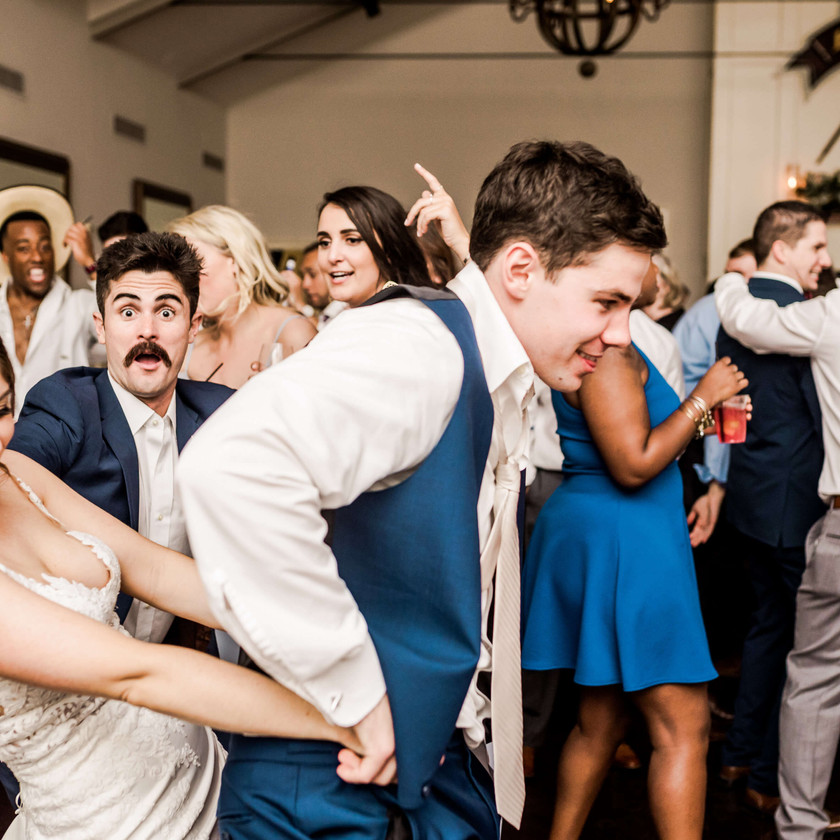 bride dancing behind groom