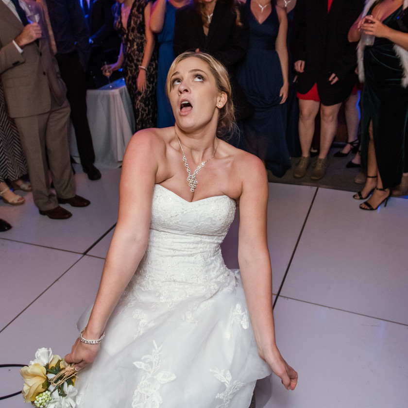 bride dancing about to throw bouquet