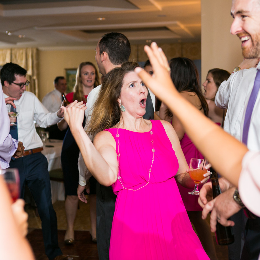 woman in pink dress dances