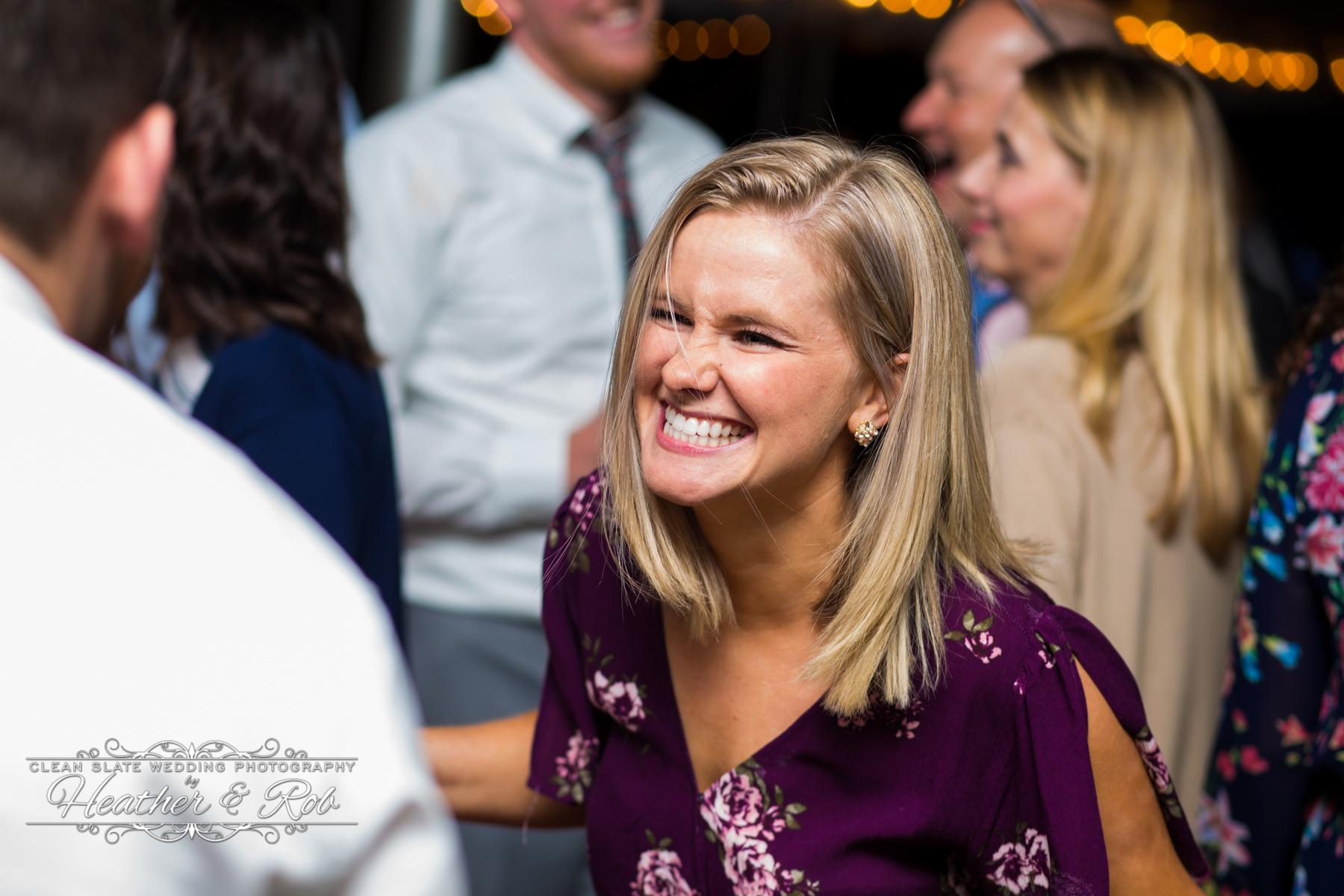 woman smiling while dancing at wedding
