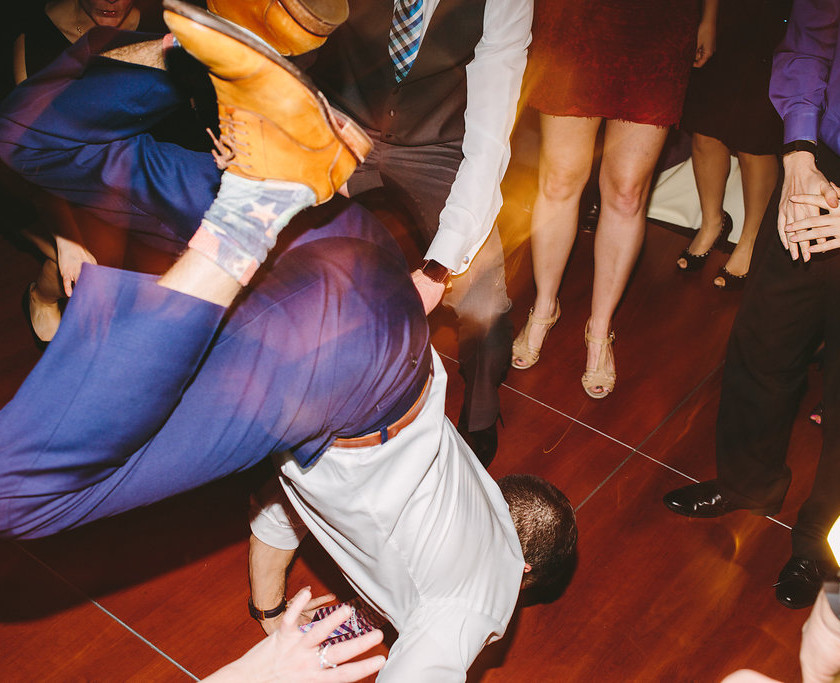 guy does the worm on the dance floor