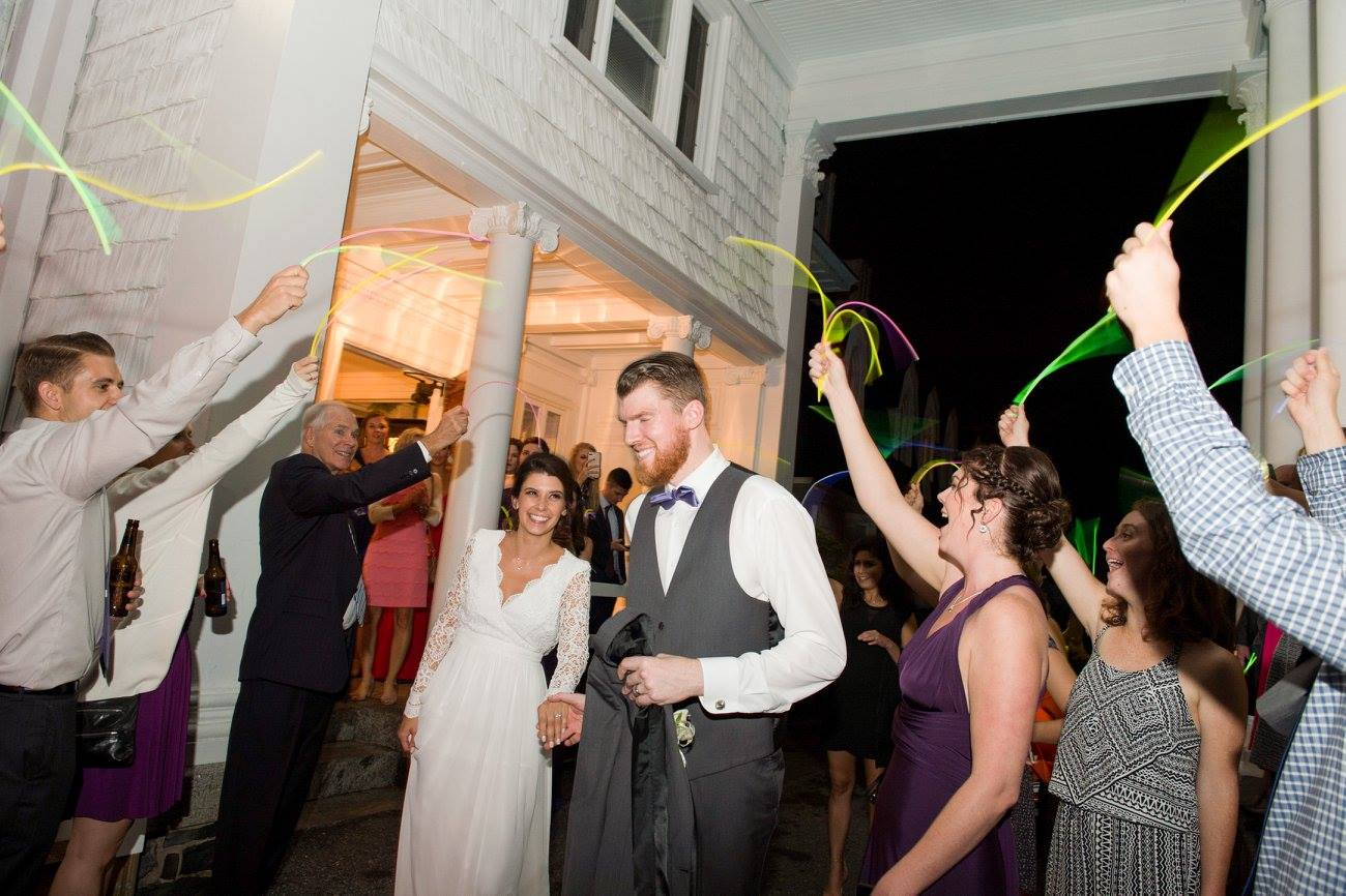 bride and groom walk out during glow stick exit at wedding