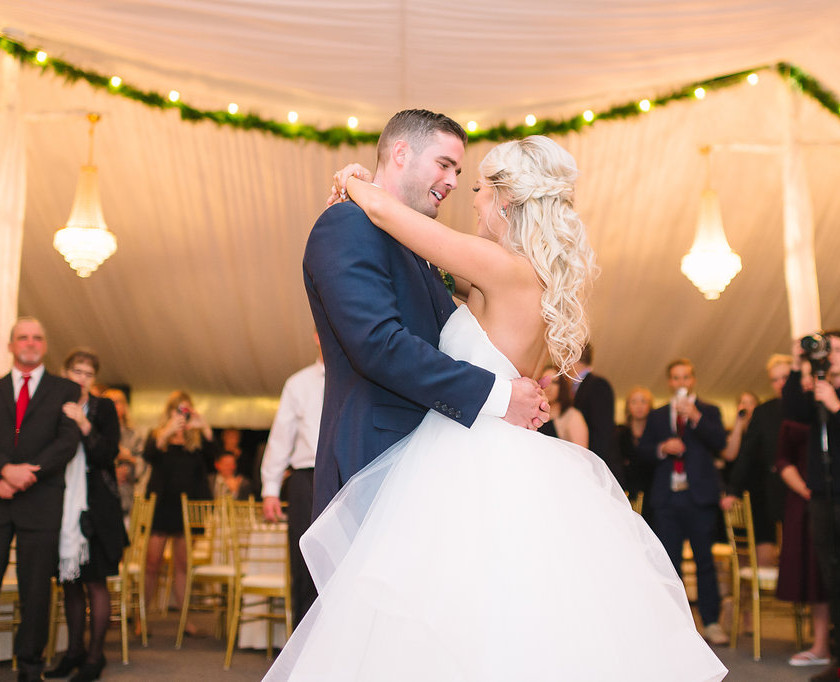 bride and groom first dance in tent