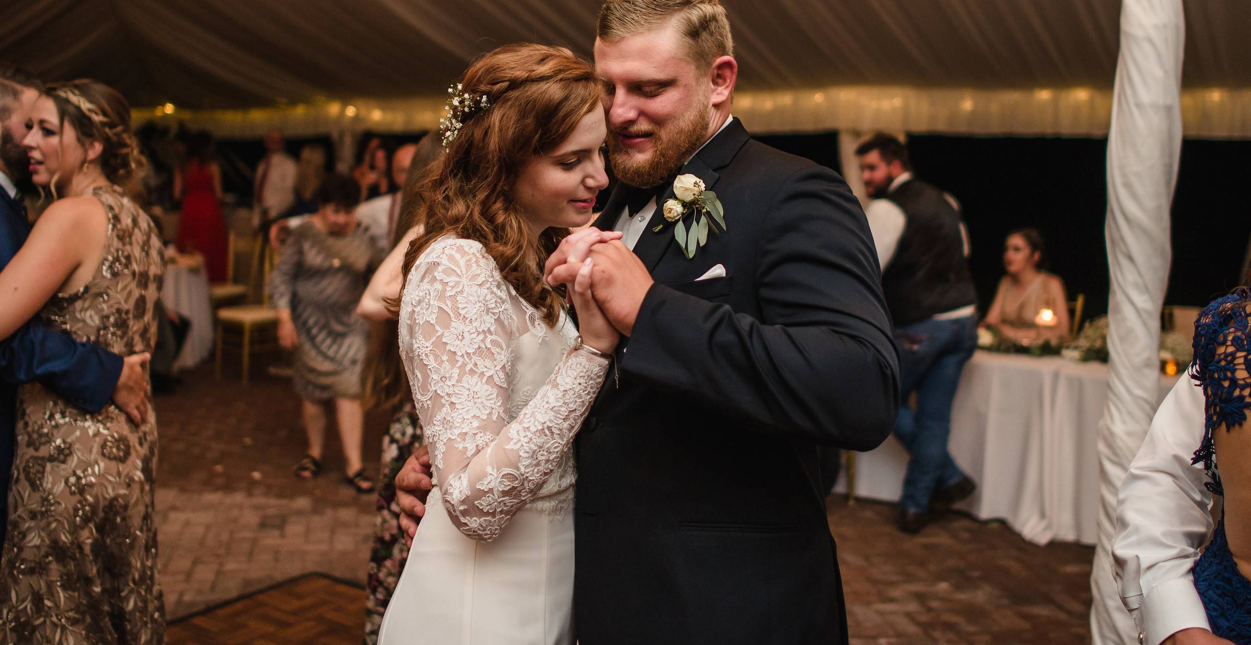 bride and groom slow dancing at wedding