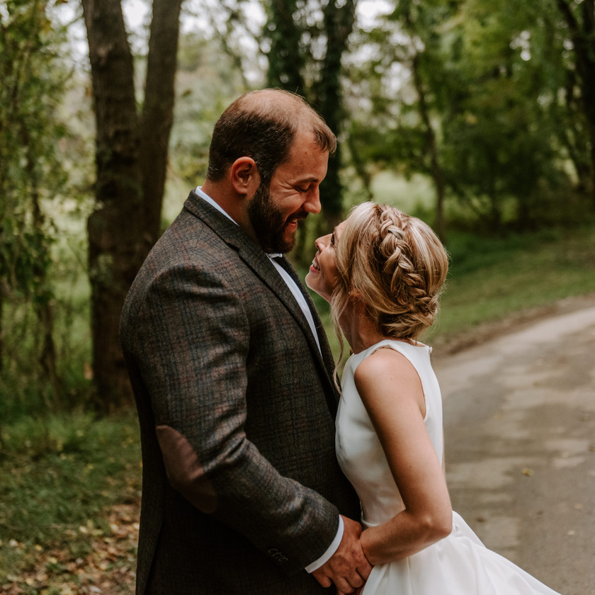 bride and groom pose on lane