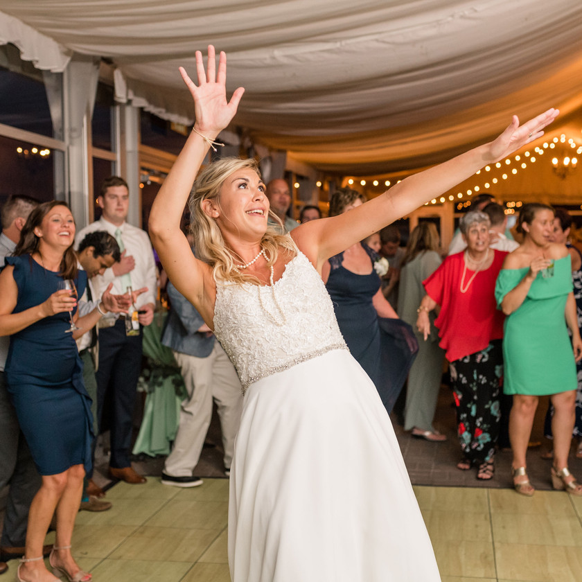 bride waves hands while dancing