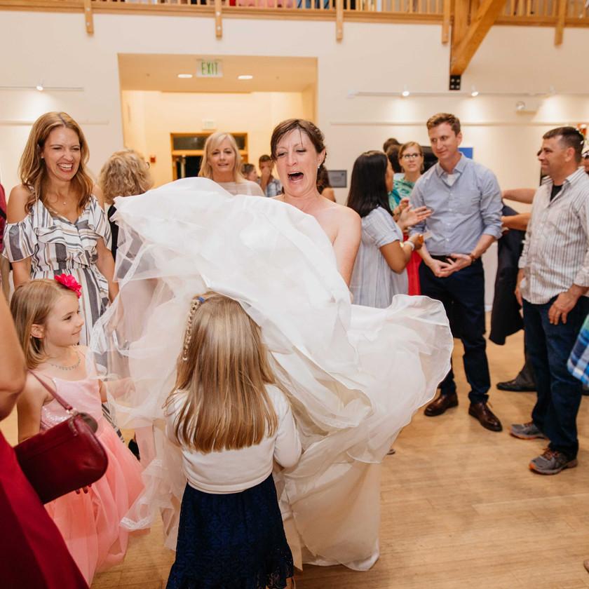 bride tossing dress over child's head
