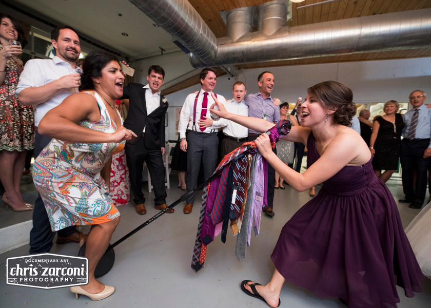 bridesmaid singing into microphone stand covered in ties