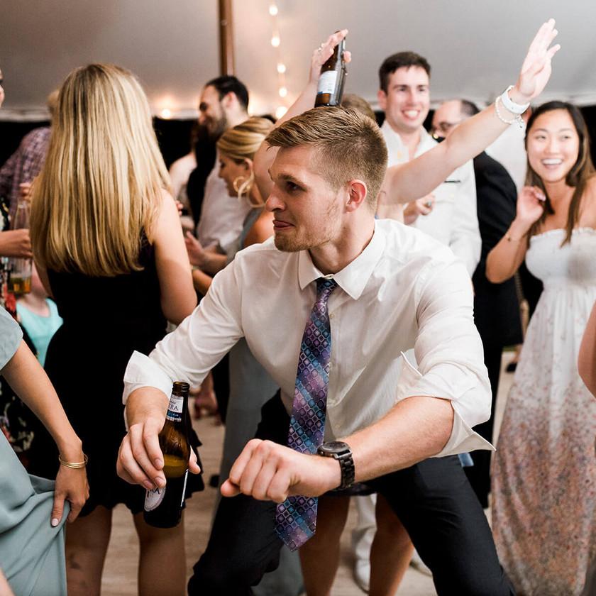 guy bends low dancing at wedding