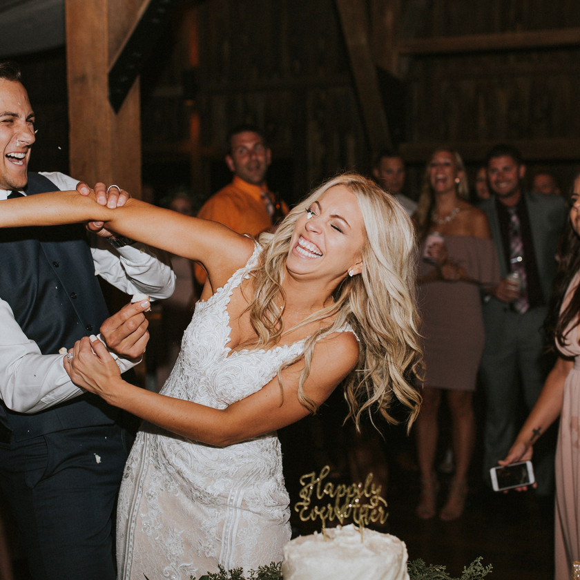 bride smashes cake into groom's face