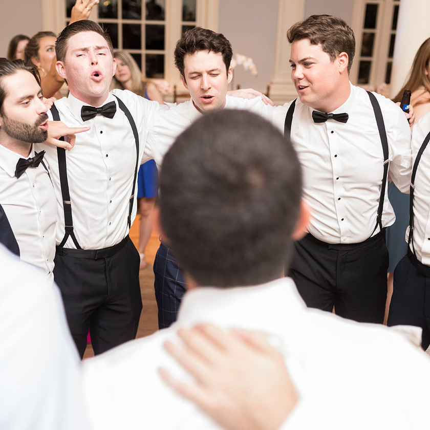 groomsman singing in a circle