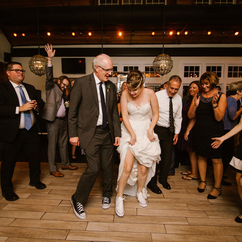 bride dances with dad and guests