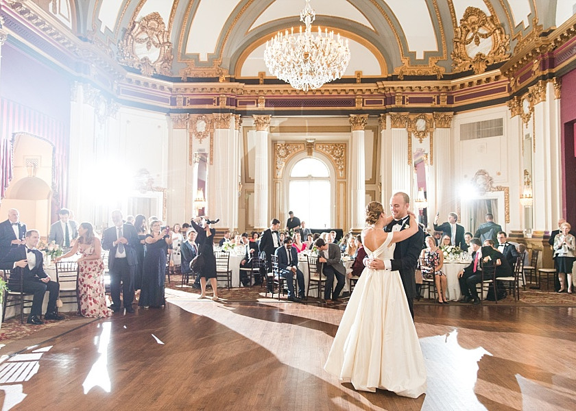 bride and groom first dance in gorgeous ballroom