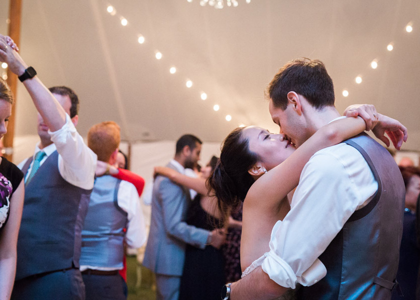 bride and groom kissing while slow dancing