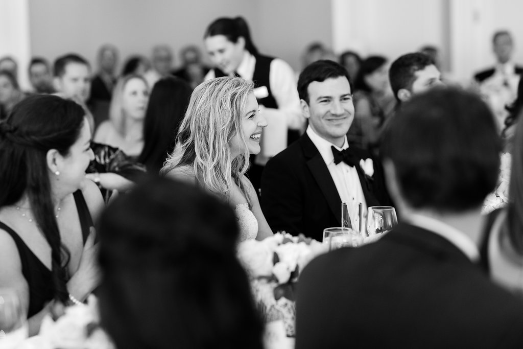 bride smiling during toasts