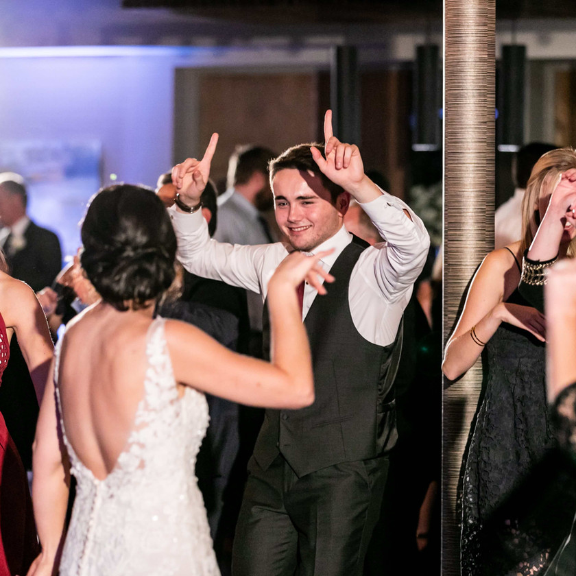 guests dance with bride