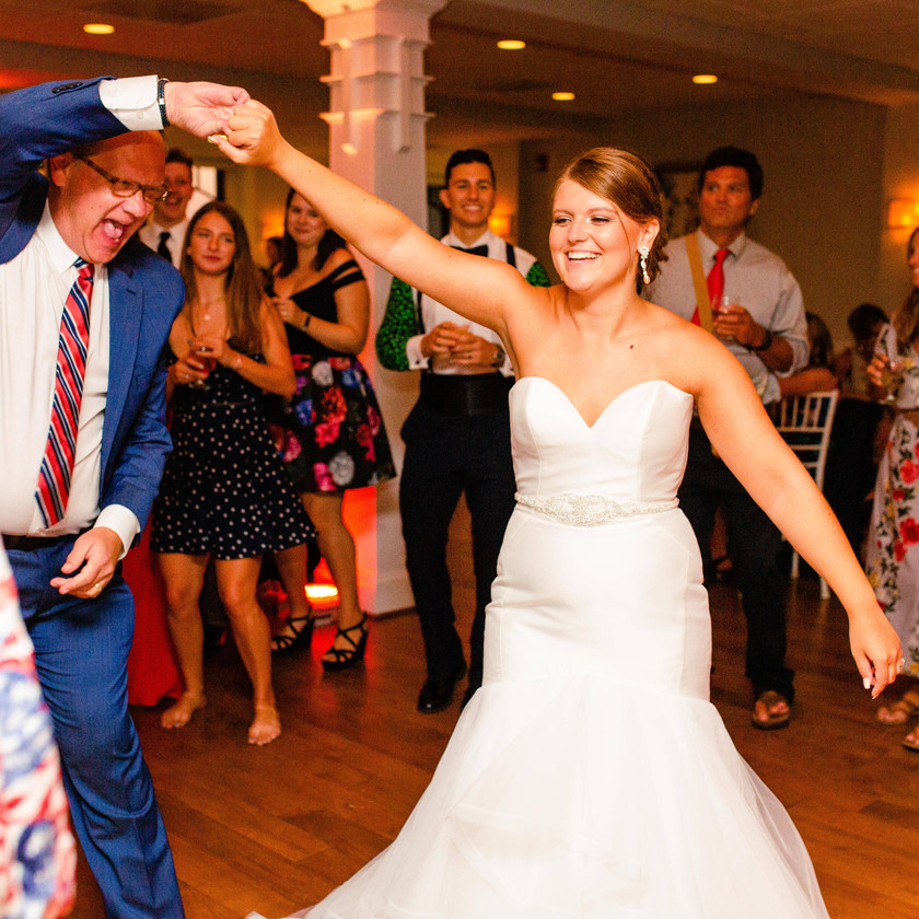 bride being spun by father while guests dance