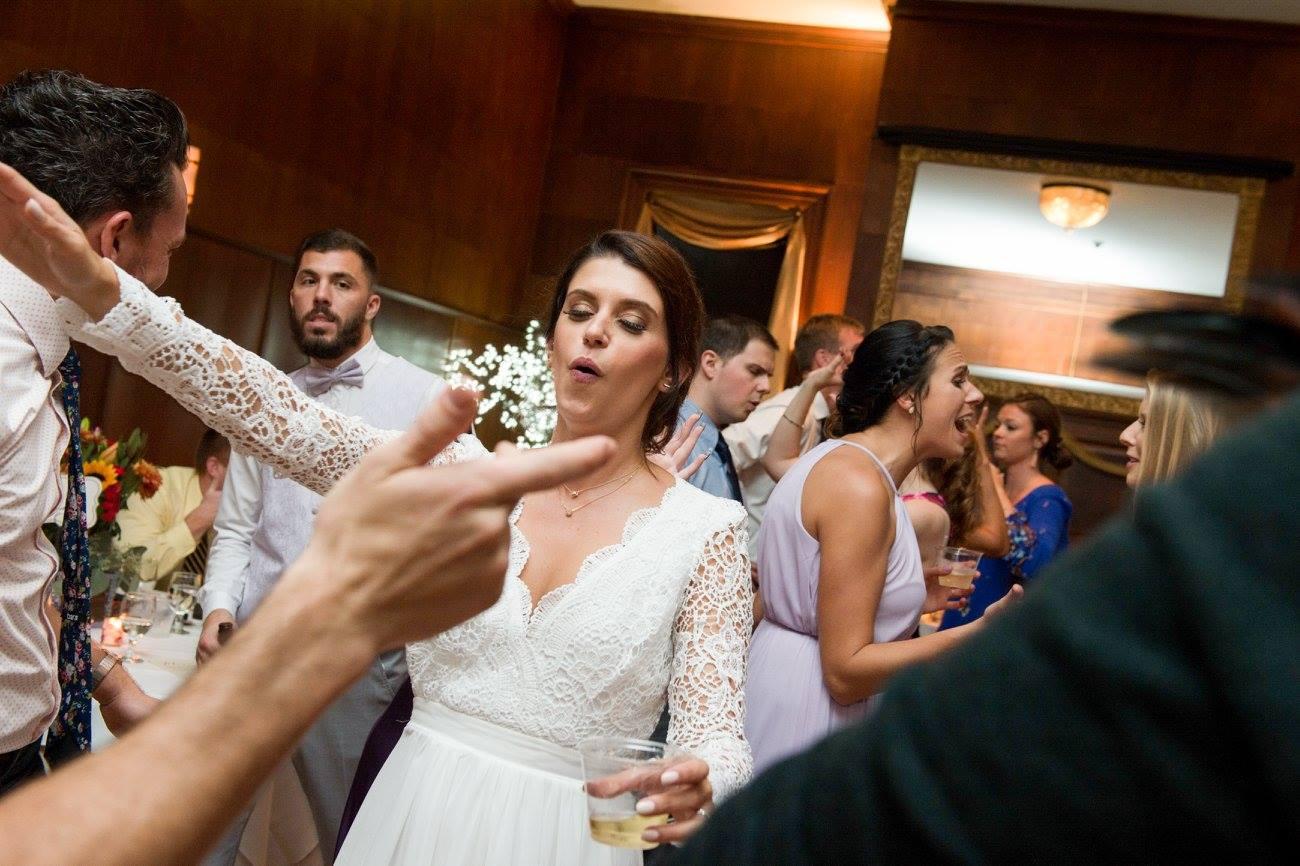 bride dances with guests