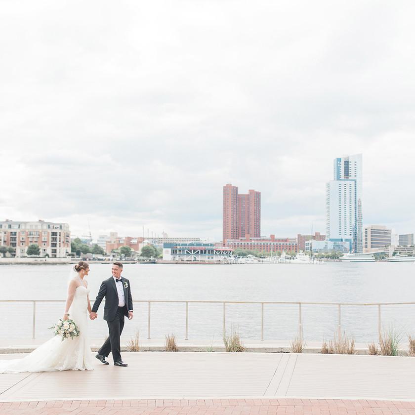 Four Seasons Baltimore waterfront wedding bride and groom walking