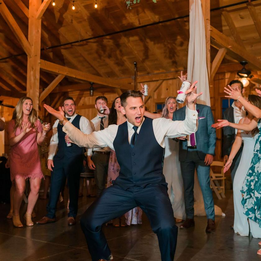 groomsman dances in the center of dancefloor