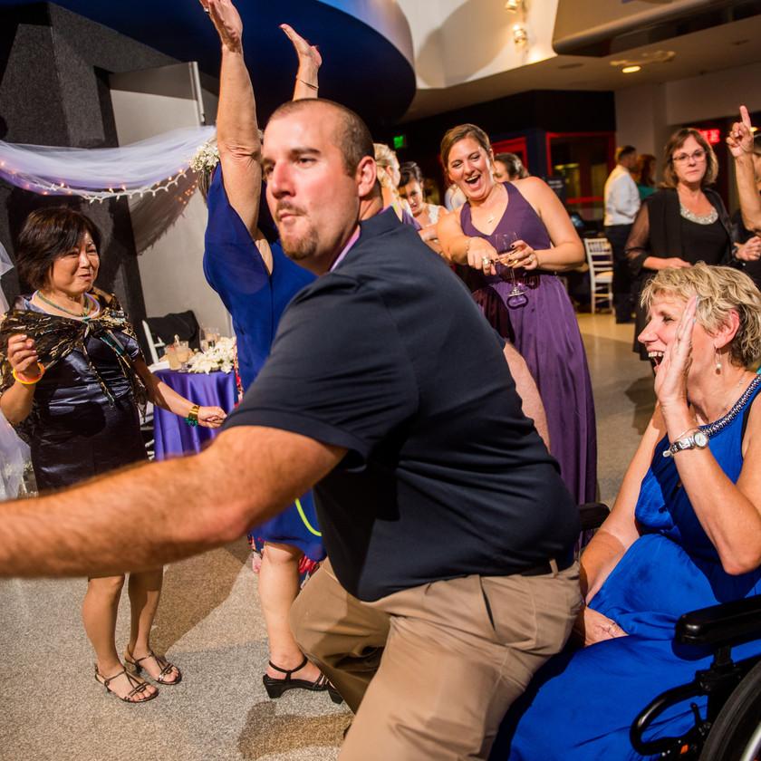 guy dances in woman's lap during wedding