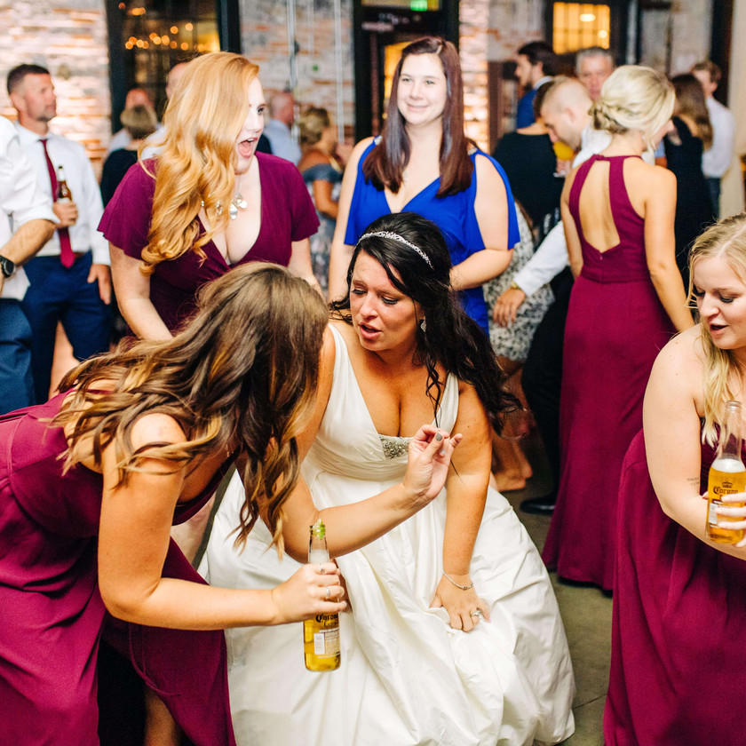 bride and bridesmaids dropping it low on the dancefloor