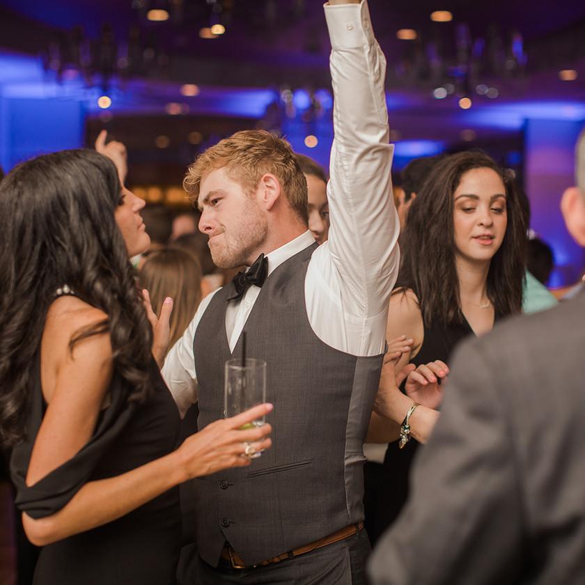 Four Seasons Baltimore wedding reception guy in vest dancing