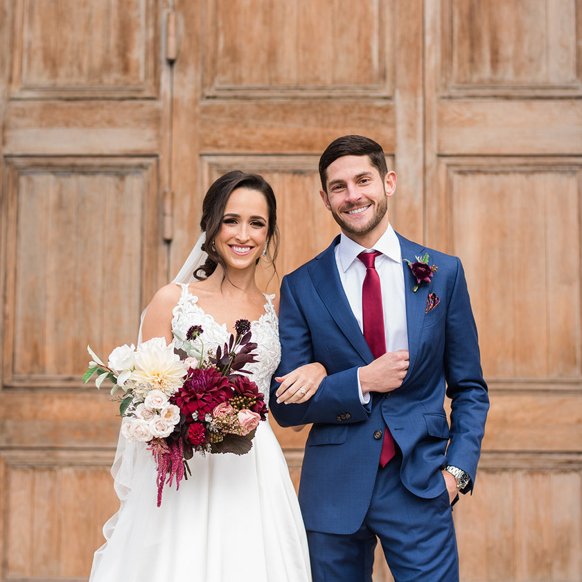 Peabody library wedding couple portrait with Steel cut flowers