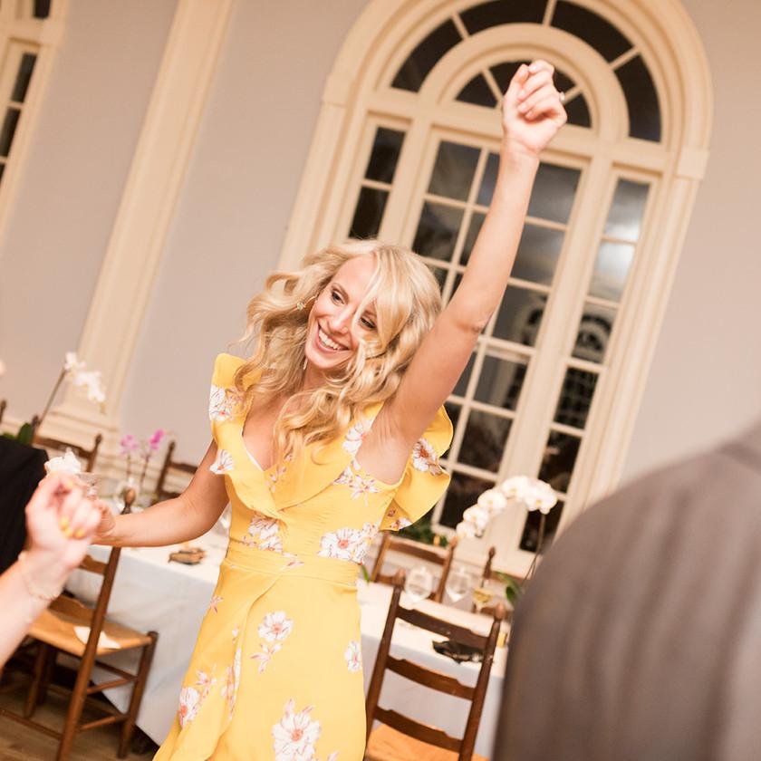 woman in yellow dress dancing