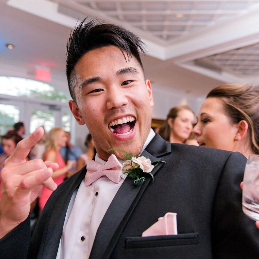groomsman dancing with drink in hand