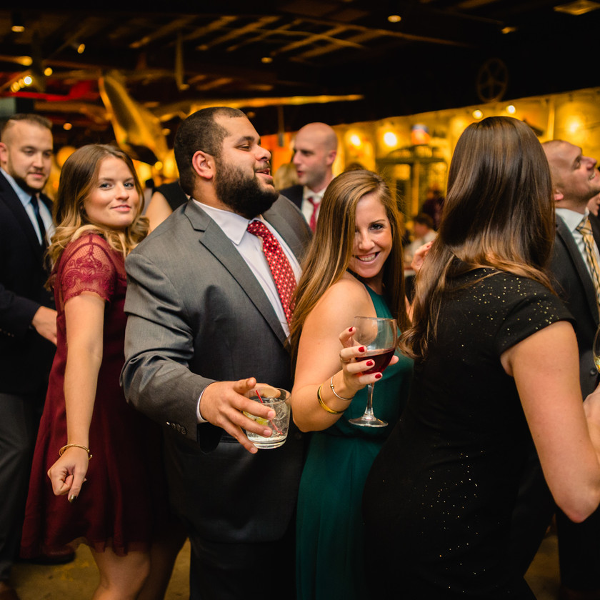 wedding guests dance in a line