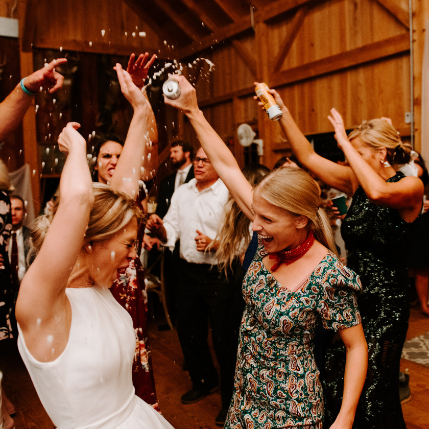 woman spraying bride with beer