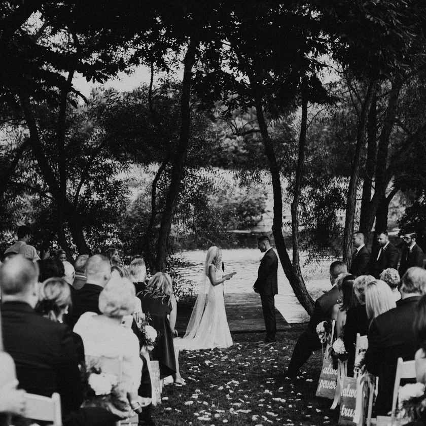 bride and groom exchanging vows at ceremony