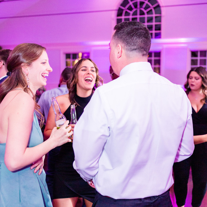 wedding guests dance and smile