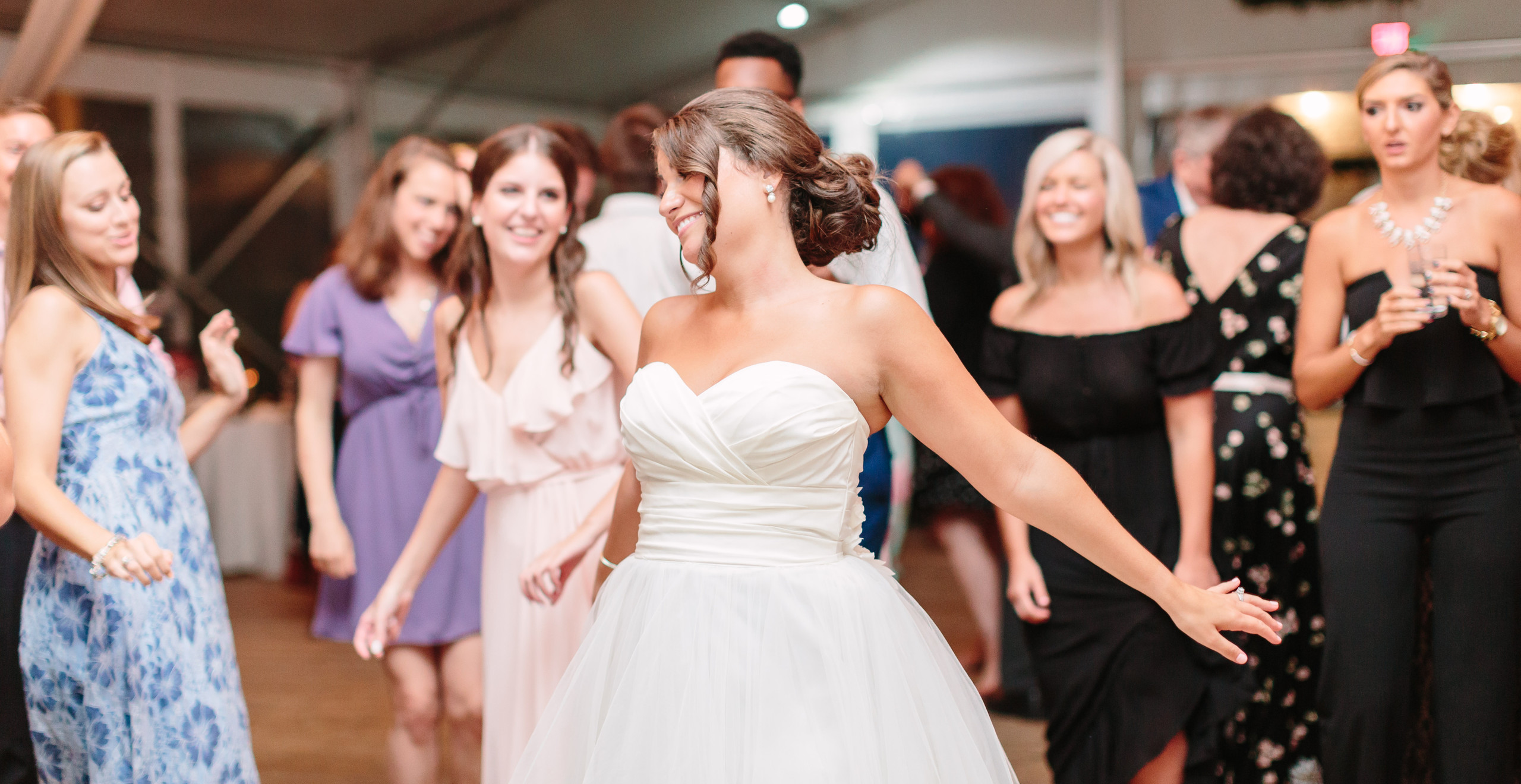 bride dancing surrounded by friends
