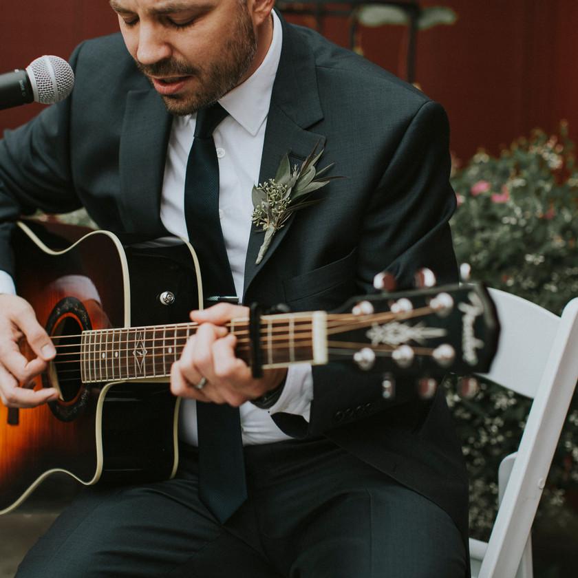 groomsmen playing guitar