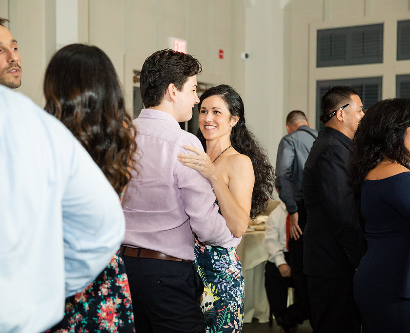 man and woman slow dance at wedding