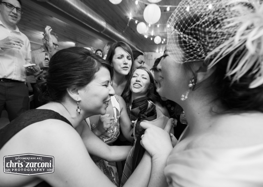 bride and friends singing in a circle
