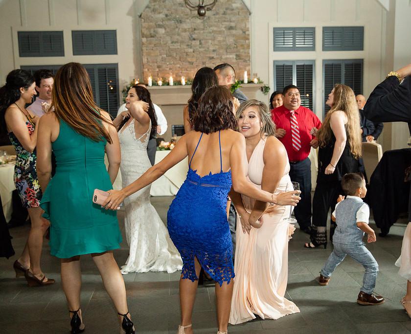 two women dance at wedding