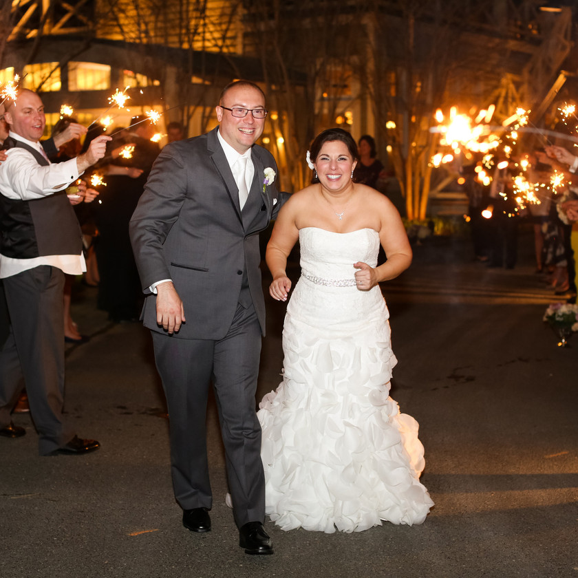 bride and groom walking out during sparkler exit