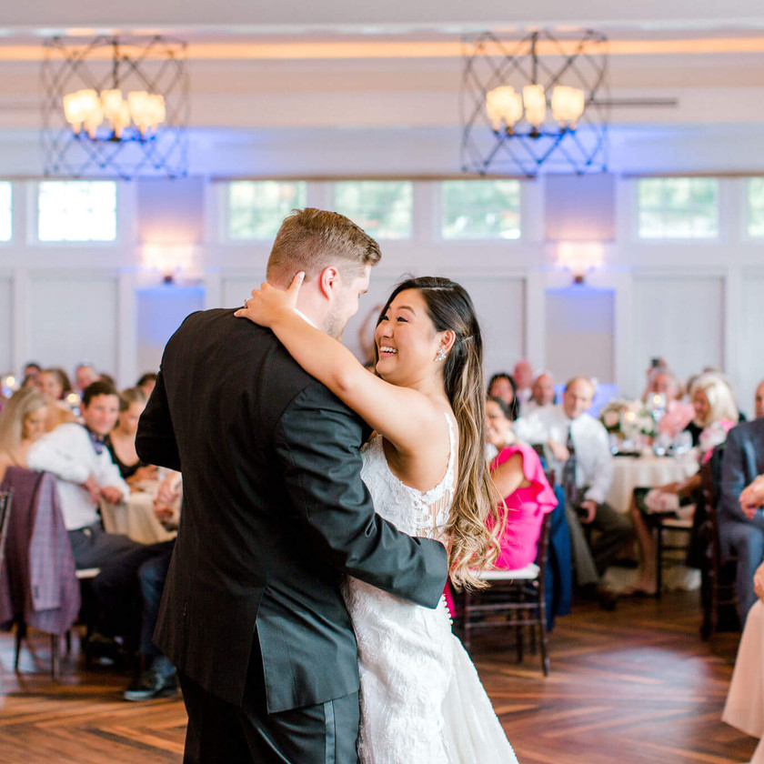bride and groom first dance in sunset ballroom