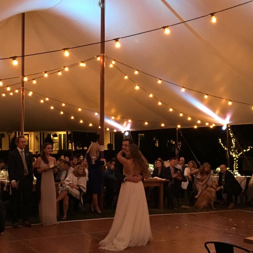 first dance underneath sailcloth tent