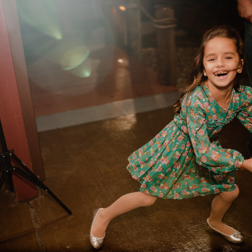 young girl in green dress dances